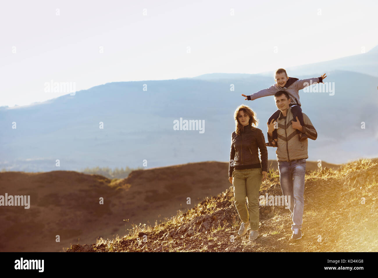 Happy family walking nature mountains area - Stock Image