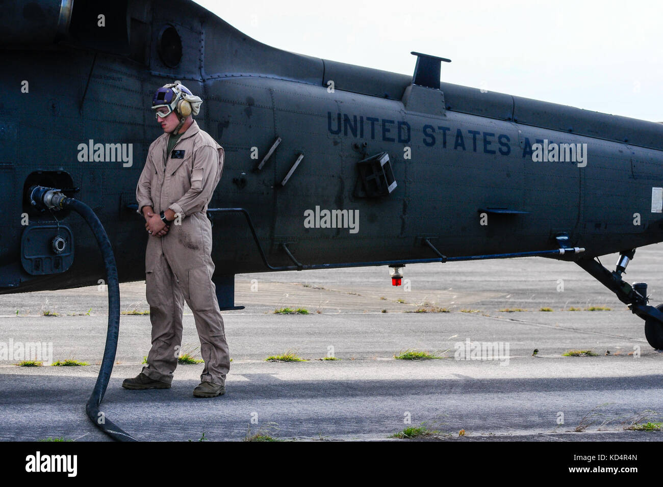 U.S. Marine Cpl. Jason D. Moxley, assigned to the 273rd Marine Wing Support Squadron, Air Operations Company, waits Stock Photo
