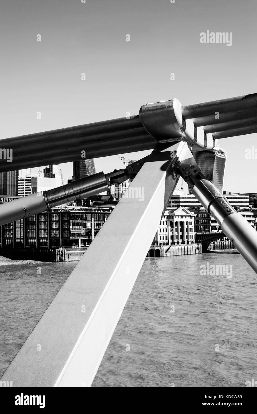 Black and White Monochrome Image of a Close Up of trhe Millennium Footbridge in London, United Kingdom Crossing - Stock Image