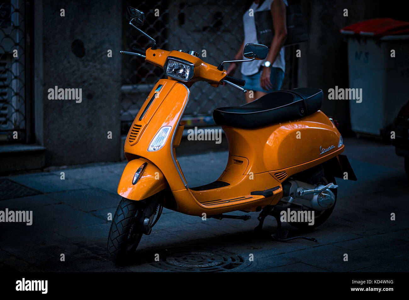 Ornage scooter on the pavement in Madrid, Spain - Stock Image