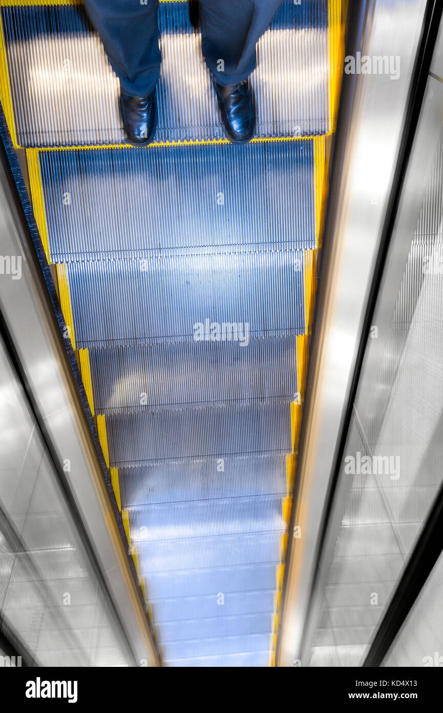 Risky Business Decision Concept Man On Tall Escalator - Stock Image