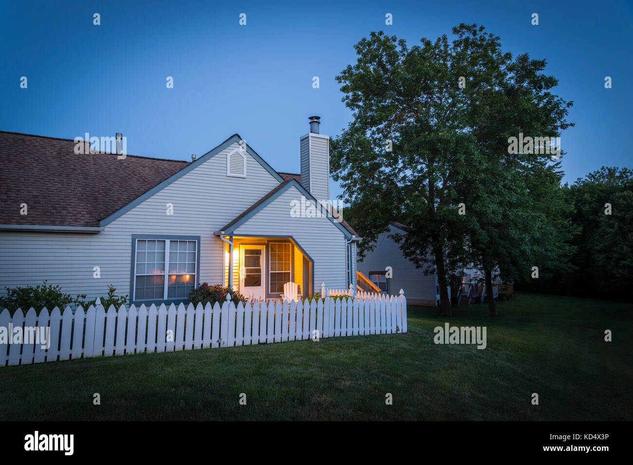 Warm Porch Light At Home On Late Summer Evening - Stock Image