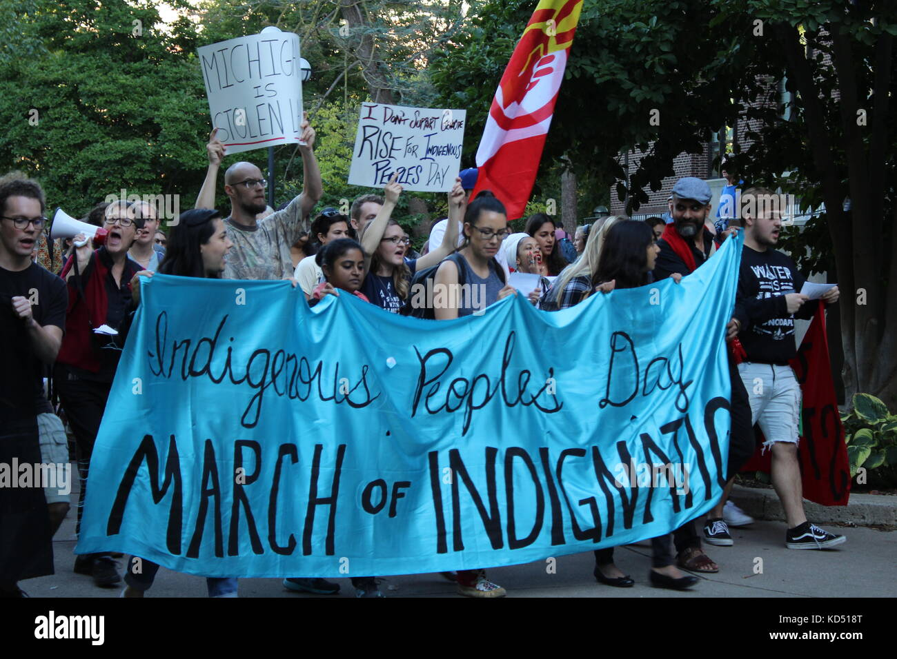 A protest in downtown Ann Arbor about hate, native americans, and Columbus Day - Stock Image