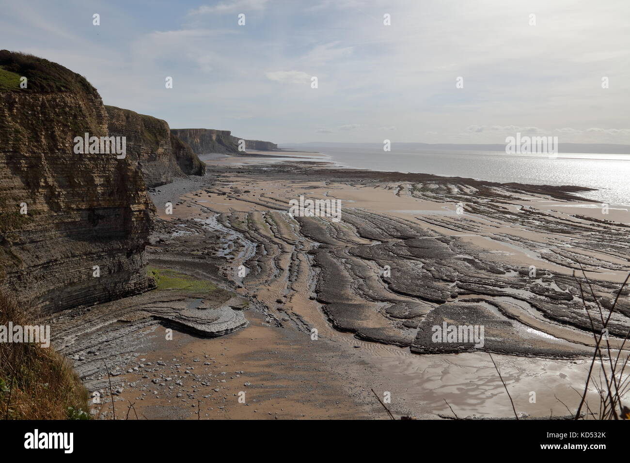 The remote unspoilt coastline between Dunraven bay and Nash point being fairly inaccesible leaves the bays and beaches - Stock Image
