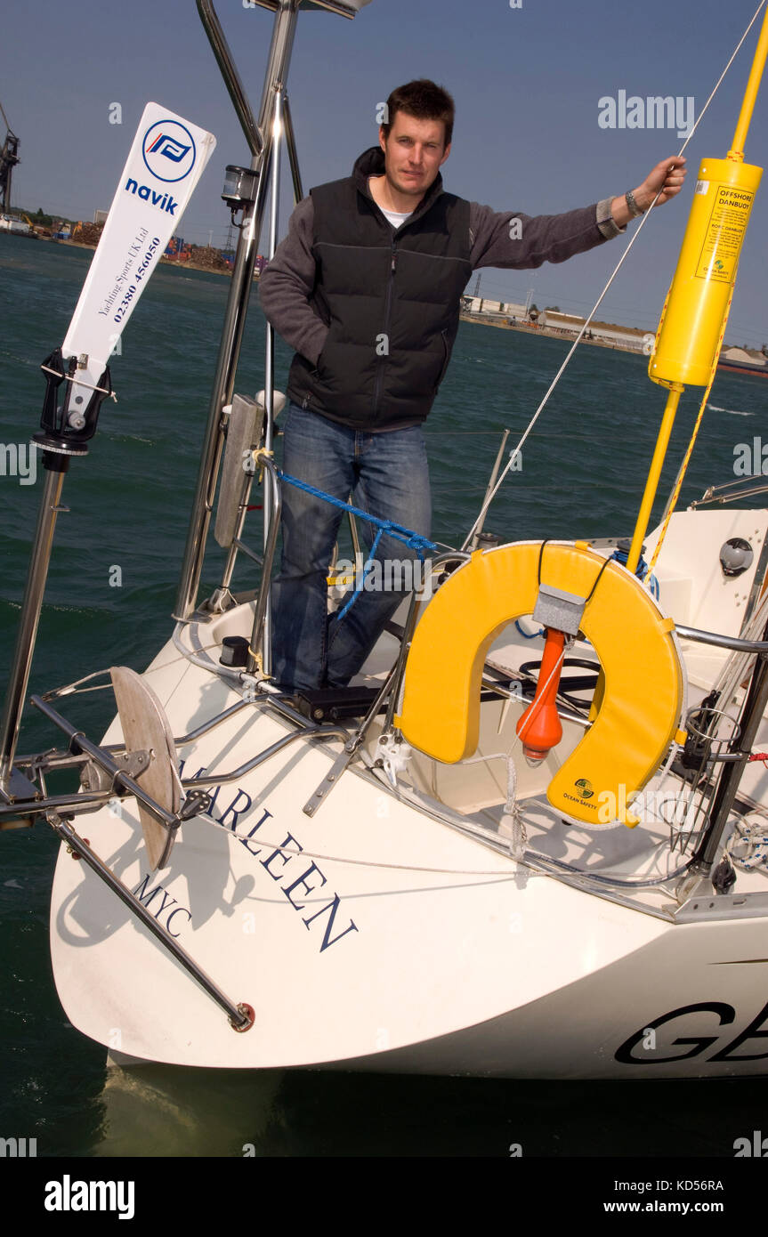 Yachtman Will Sayer with his yacht in Marchwood Yacht Club. - Stock Image