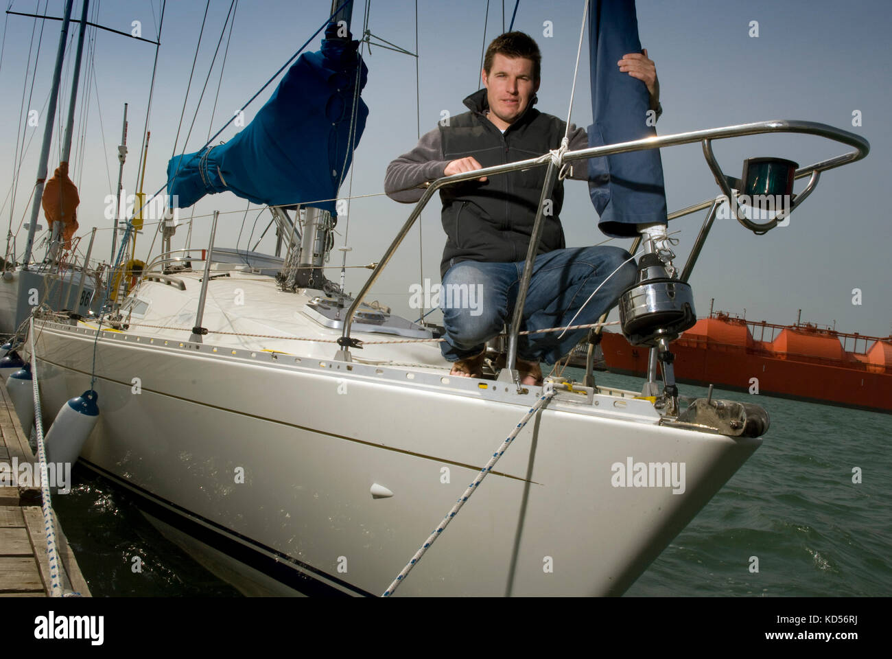 Yachtman Will Sayer with his yacht in Marchwood Yacht Club. Stock Photo