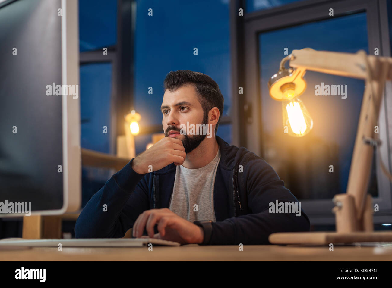 Serious male person working in the office - Stock Image