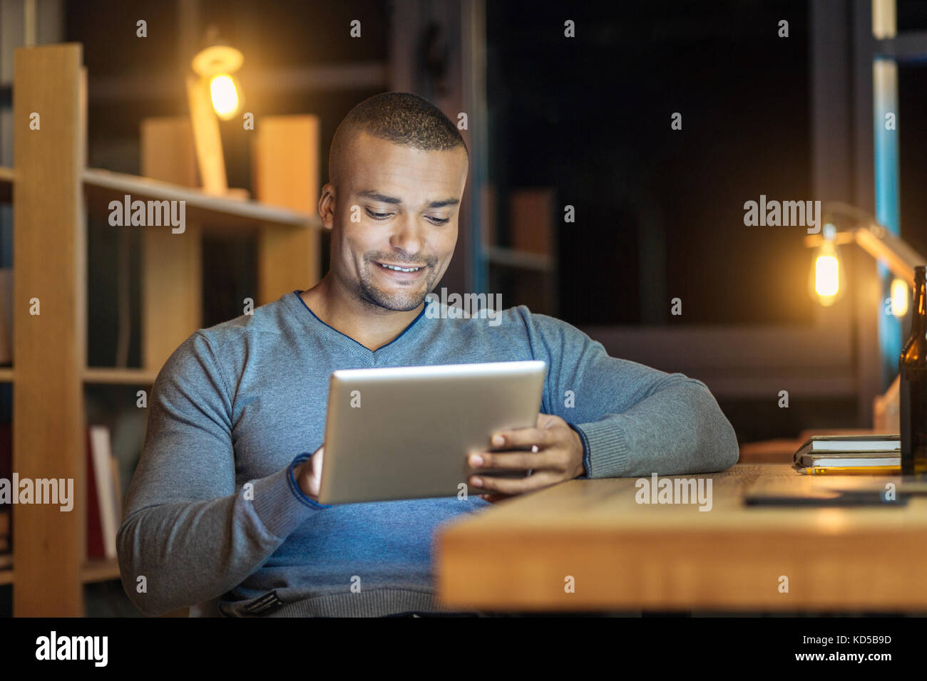 Positive delighted man being at work - Stock Image