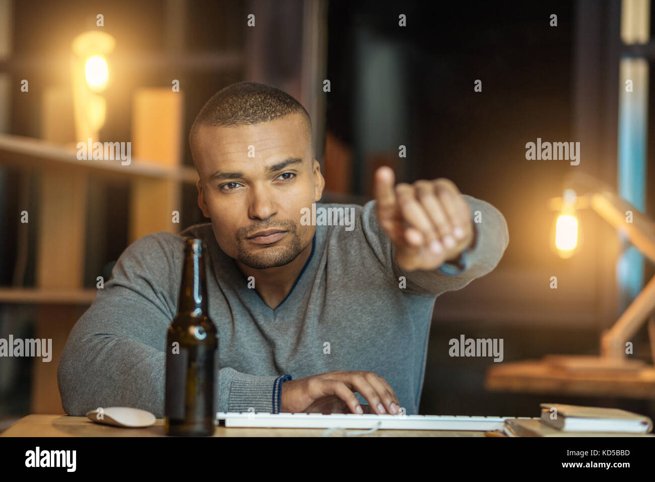 Concentrated man pointing at screen - Stock Image
