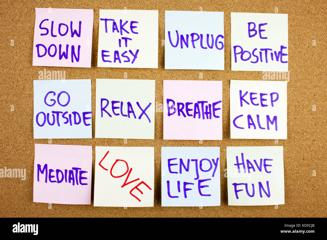 A yellow sticky note writing, caption, inscription Slow down, take ir easy be positive go outside relax breathe - Stock Image