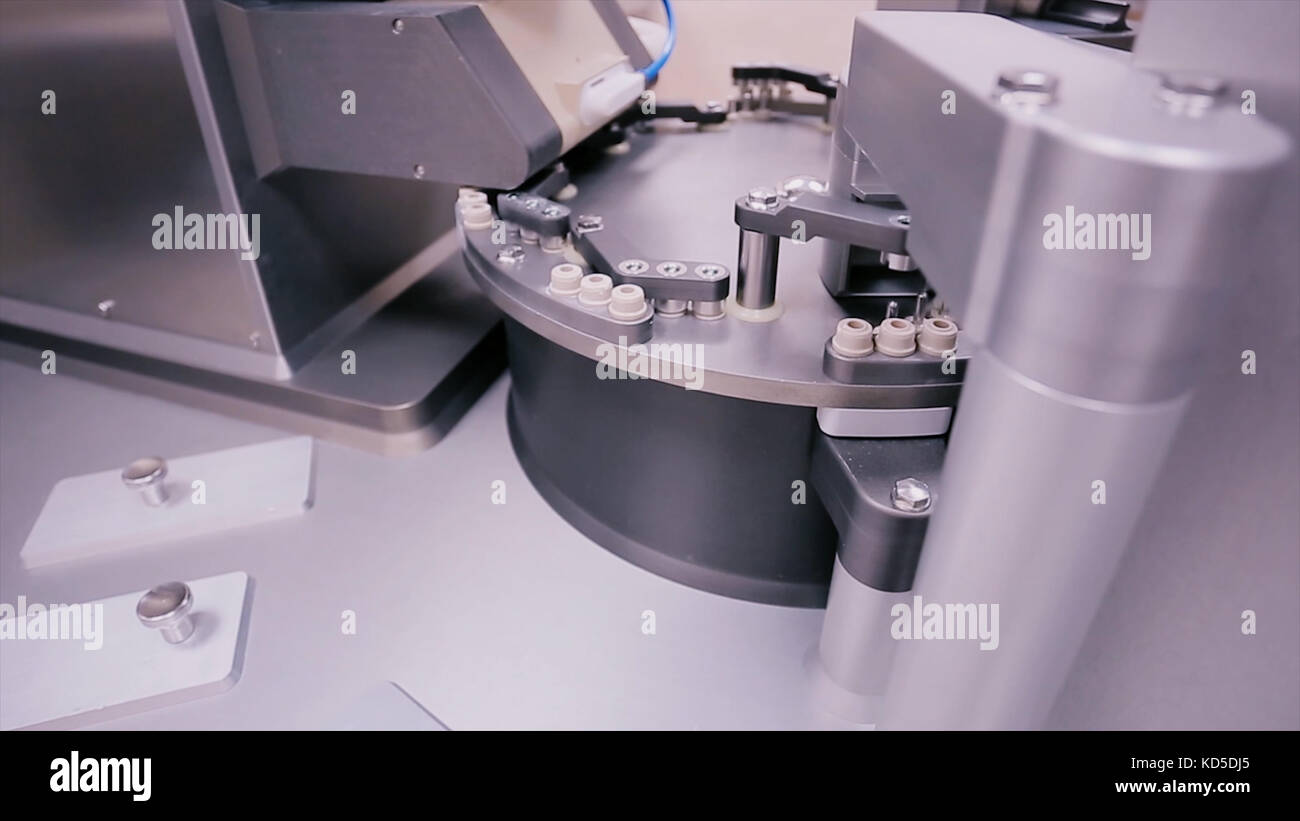 Pharmaceutical industry. Production line machine conveyor. Pharmaceutical machine. - Stock Image