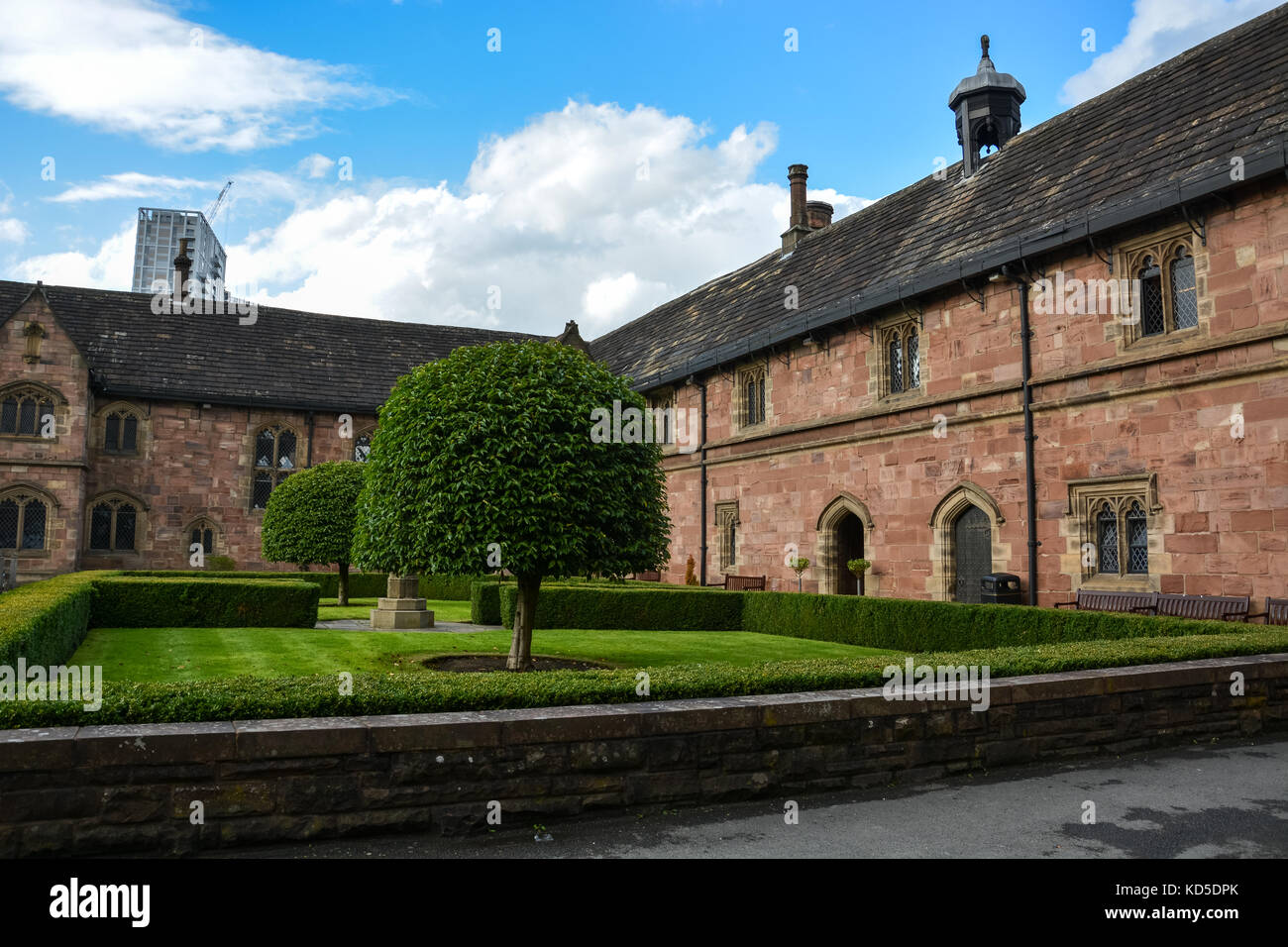 A nice square with trees and hedges next to Chetham's library in Manchester on a sunny day - Stock Image
