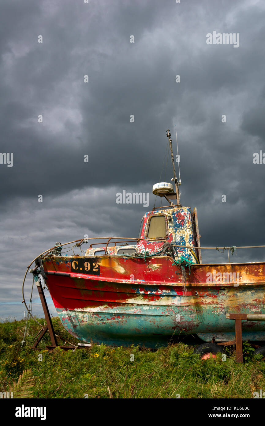 Old Fishing boat with pealing paint at Kilmore quay,county wexford,Ireland - Stock Image
