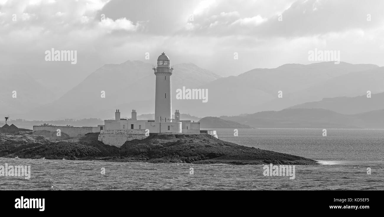Scottish landscape with Lismore Lighthouse on Eilean Musdile islet, viewed from the Mull to Oban ferry in the Firth - Stock Image
