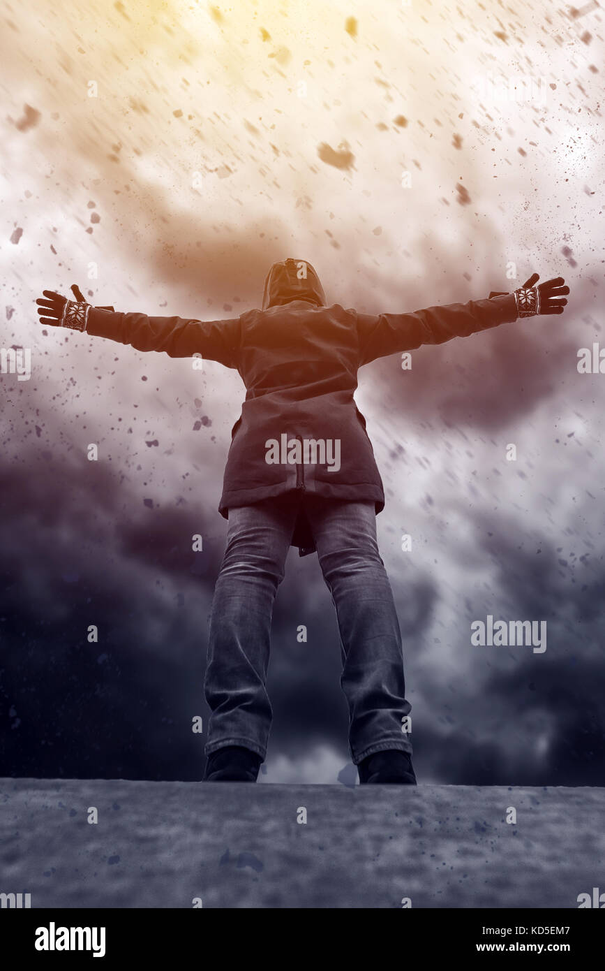 Conceptual image of young female person facing uncertain future, mixed media content with dramatic stormy clouds - Stock Image