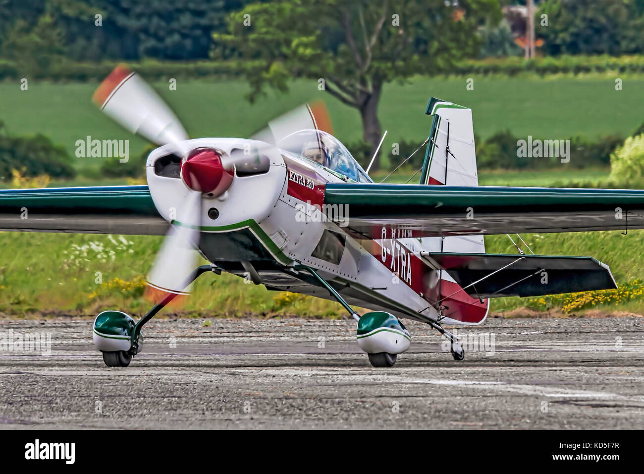Clive Butler taxies in at Wickenby in his 1987 Extra EA230 aerobatic aircraft for a visit in 2013. - Stock Image