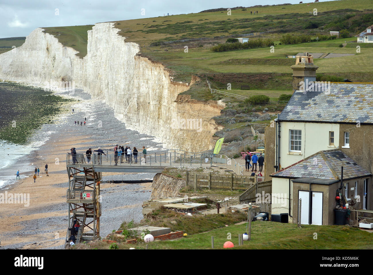 66f10234e8f8 Tourists get close to the edge of the crumbling chalk cliffs at Birlng Gap