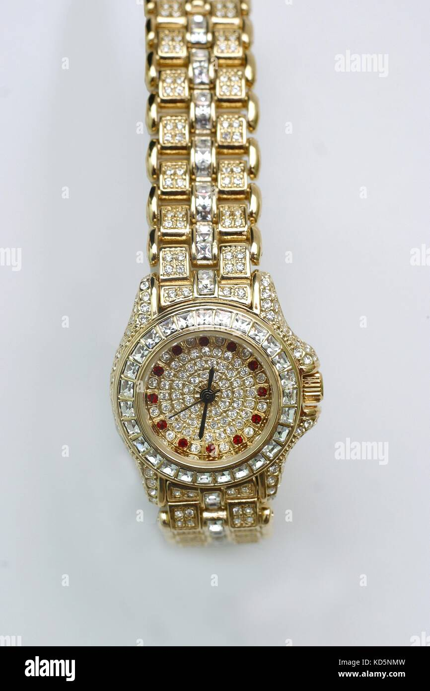 Watch encrusted with fake gold and diamonds 3ef7a3ceef