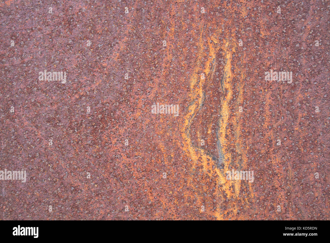 Rust on metal surfaces Caused by a reaction of metal and air humidity. - Stock Image
