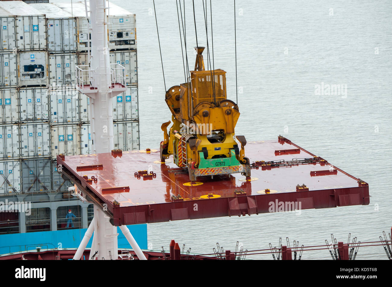 Hatch cover being craned into position on a container ship