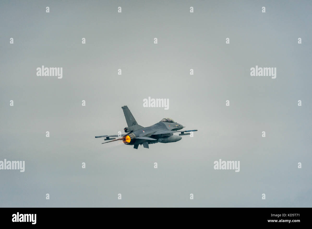 An F-16 fighter takes off from the military airbase in Leeuwarden. Stock Photo