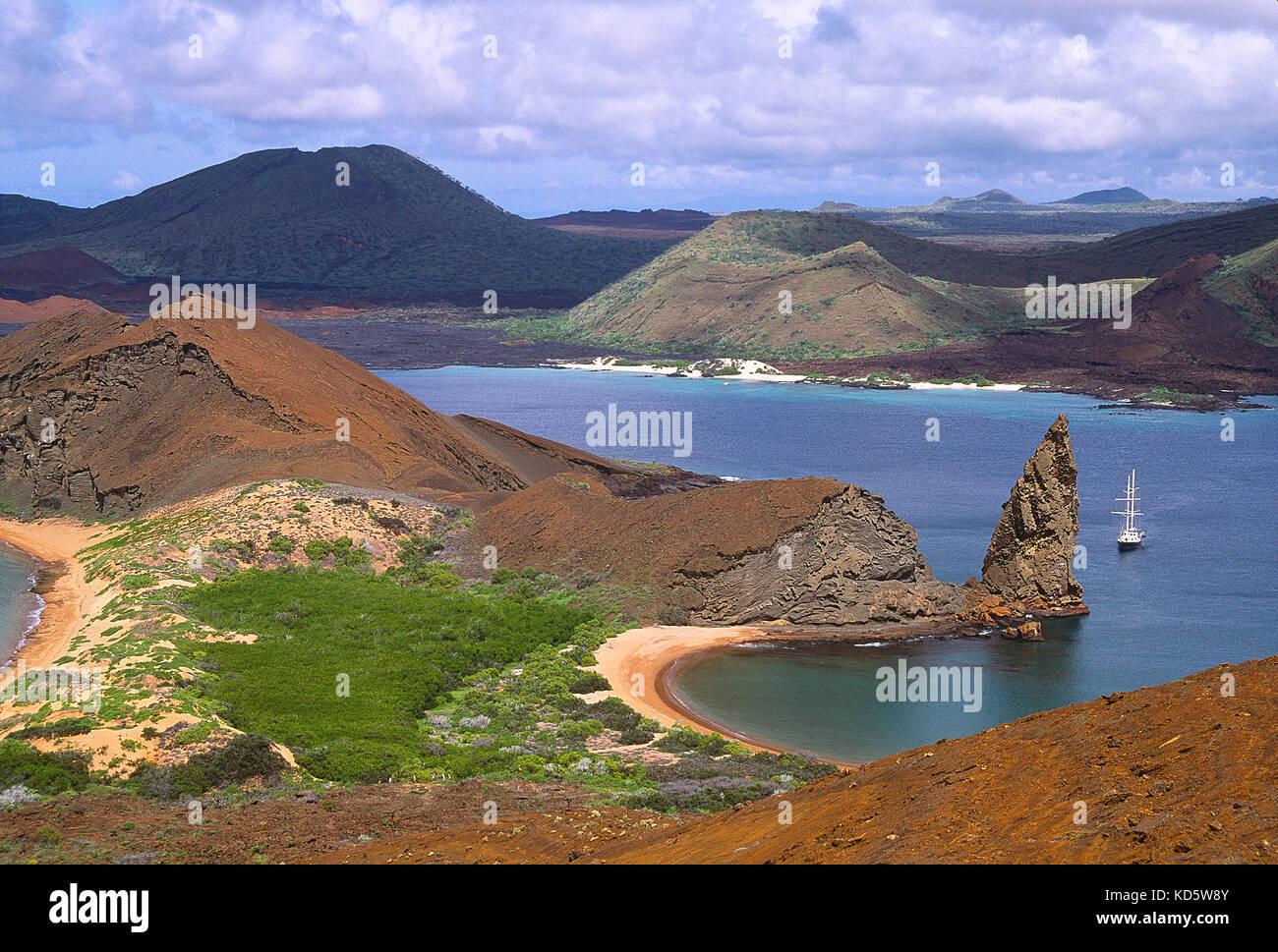 Galapagos Islands.Bartolomé Island, High viewpoint of coastal bays and Pinnacle Rock. - Stock Image
