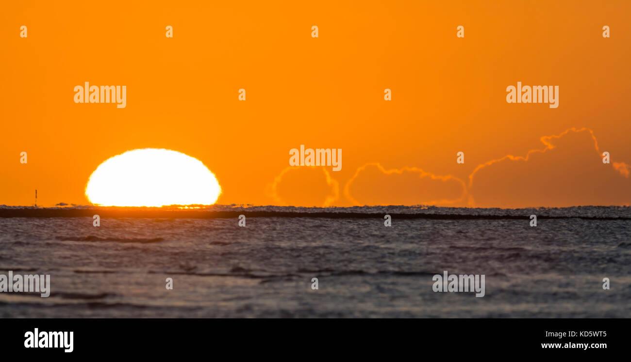 Sun rising over the sea. Sunrise over the ocean. - Stock Image