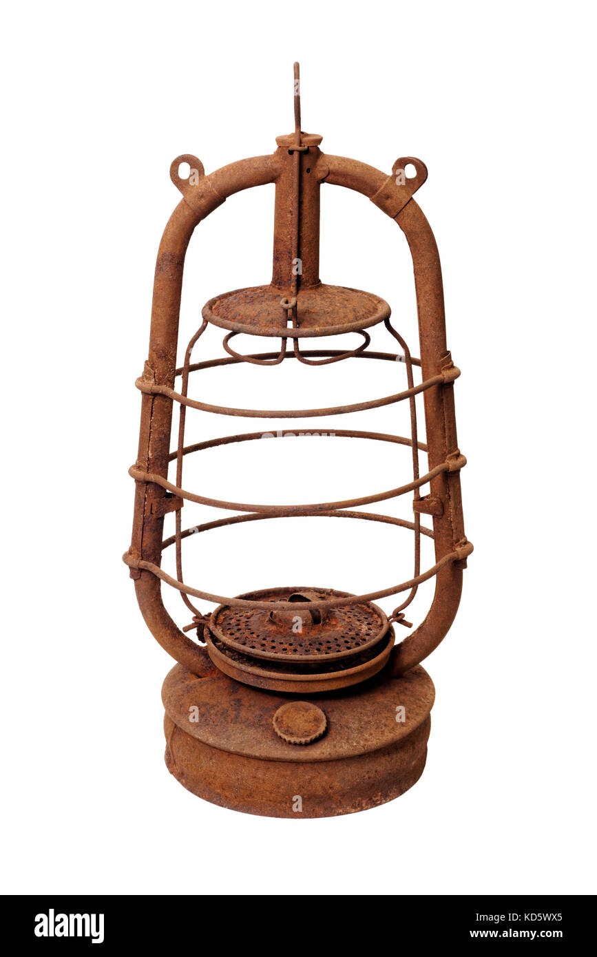 Isolated objects: very old shabby and rusty kerosene lamp, without glass, on white background - Stock Image