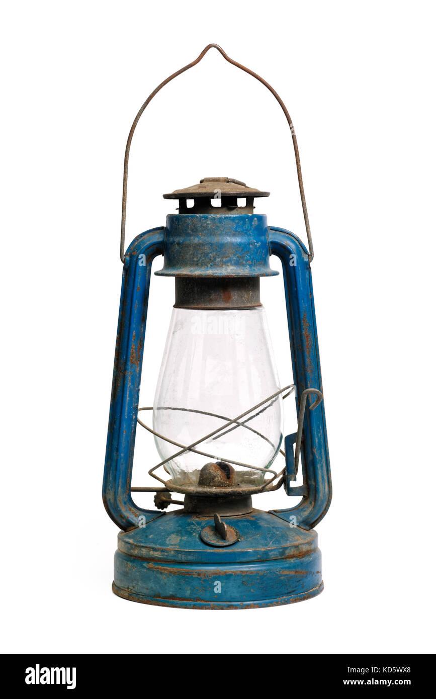 Isolated objects: very old shabby and rusty blue kerosene lamp, on white background - Stock Image