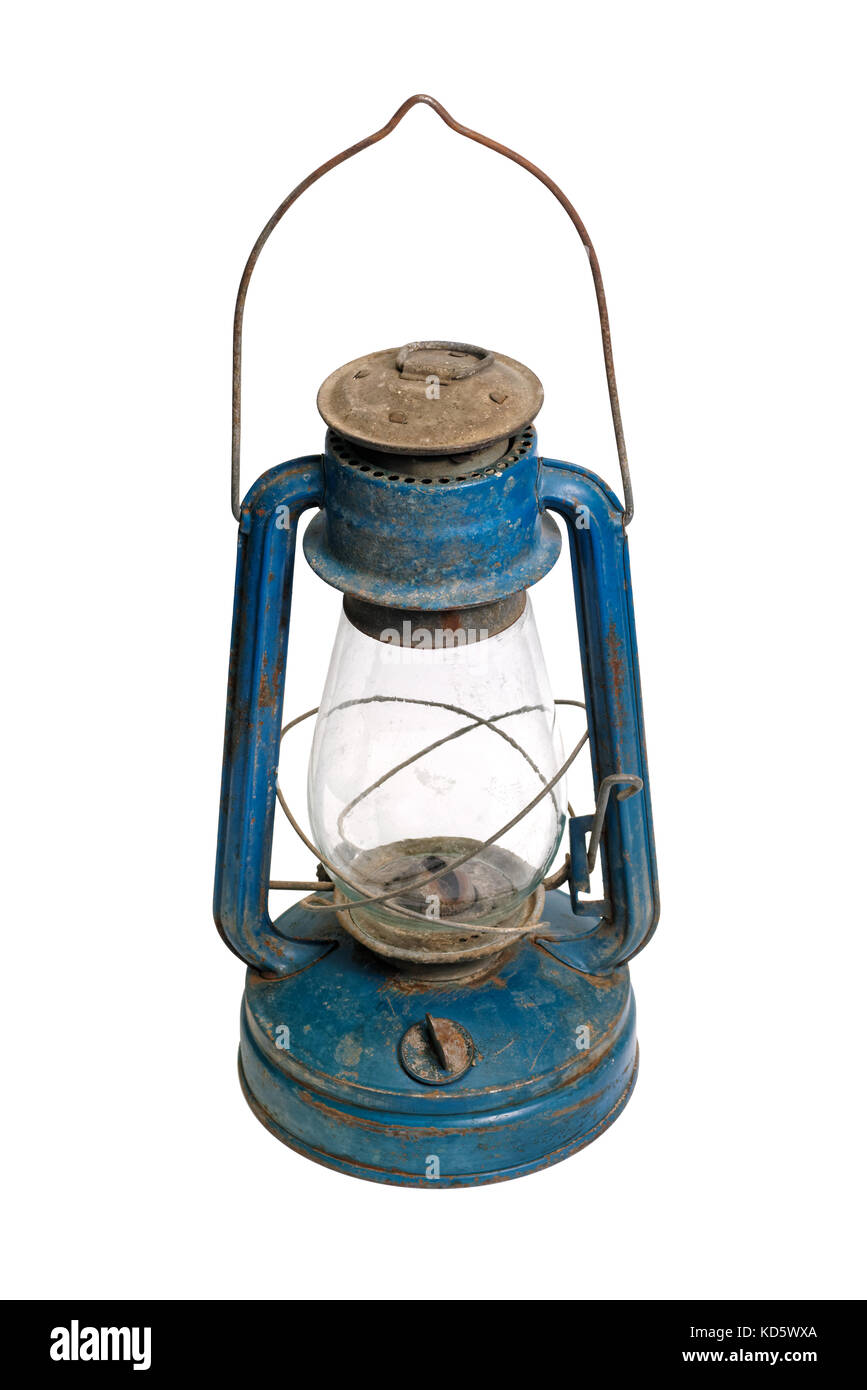 Isolated objects: very old shabby and rusty blue kerosene lamp, on white background - Stock Image
