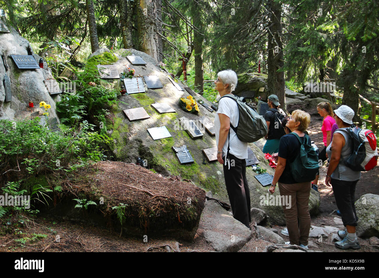 POPRADSKE PLESO, SLOVAKIA - AUGUST 27, 2015: People visit the symbolic cemetery in High Tatras, a memorial to people Stock Photo