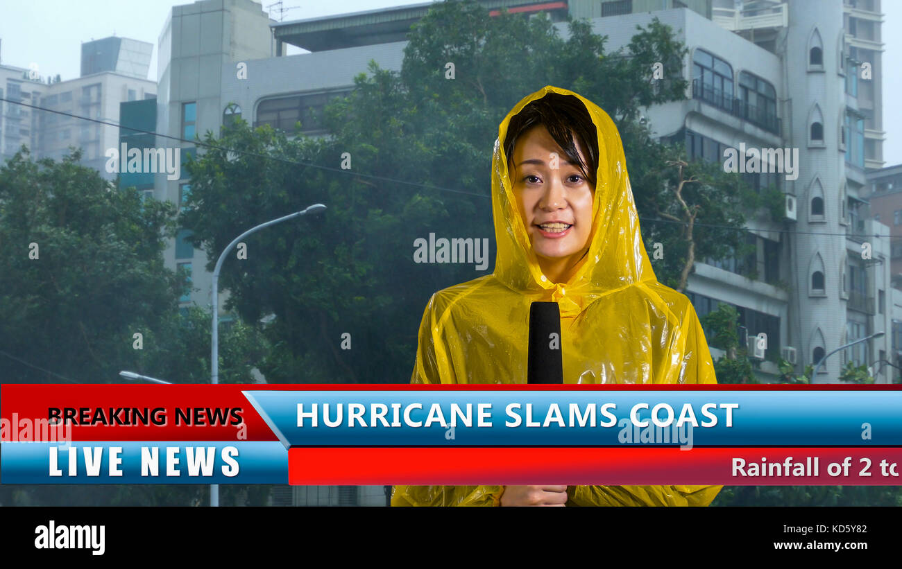 Asian American weather reporter live report in storm - Stock Image