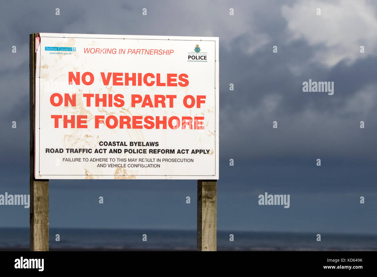 A 'No Vehicles' warning sign on the beach at Southport in Merseyside - Stock Image