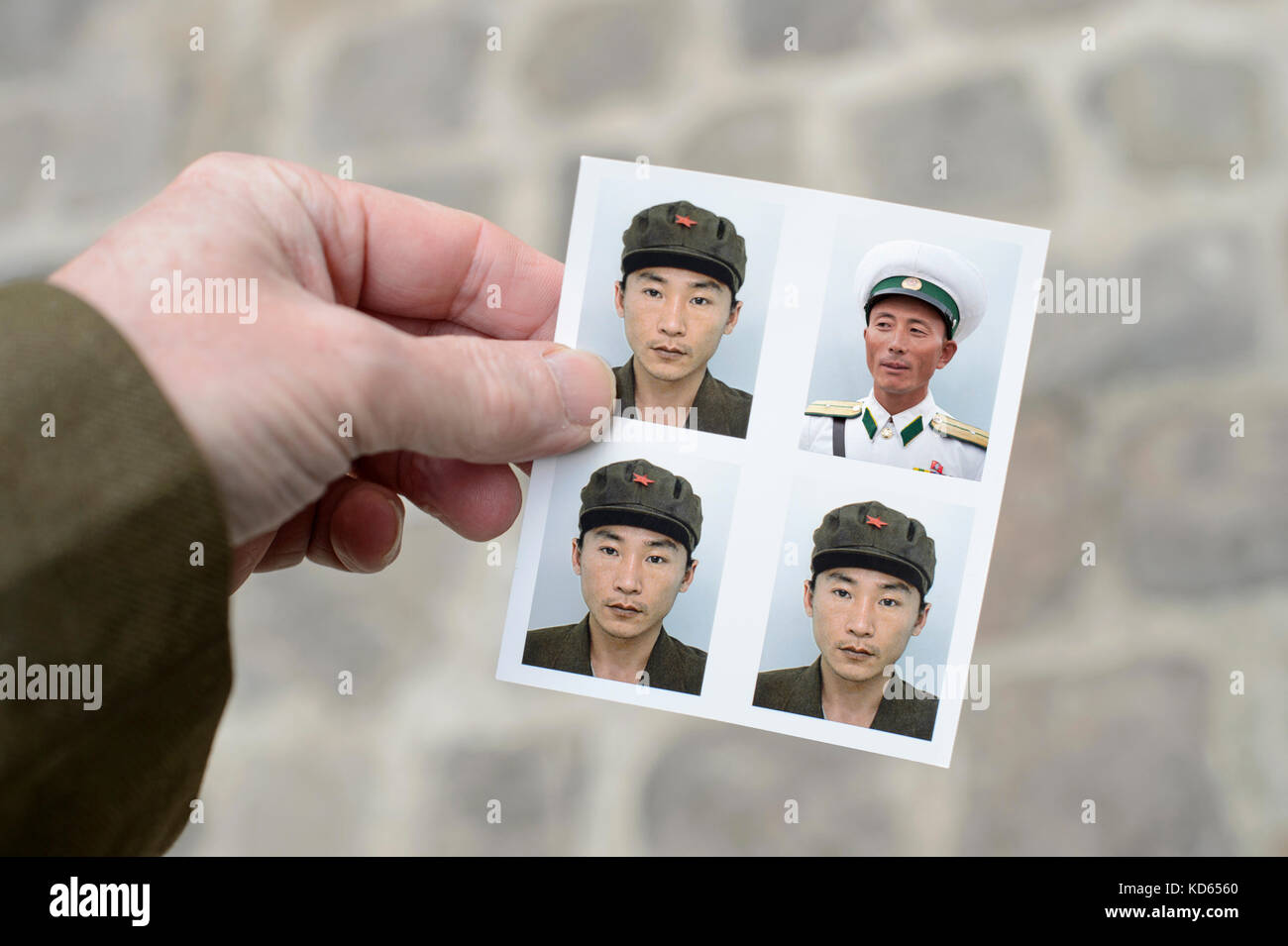 My pictures shows one reality intertwined with a modern fable. I settled my work with a North Korean tourist in - Stock Image
