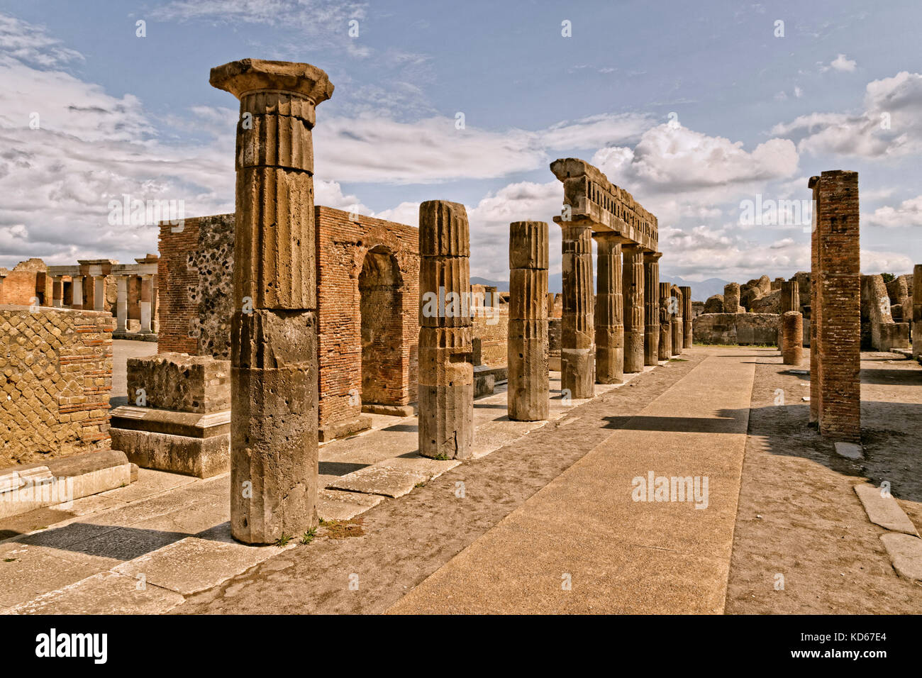 Columns at the Forum area in the ruined Roman city of Pompeii at Pompei Scavi near Naples, Italy. - Stock Image