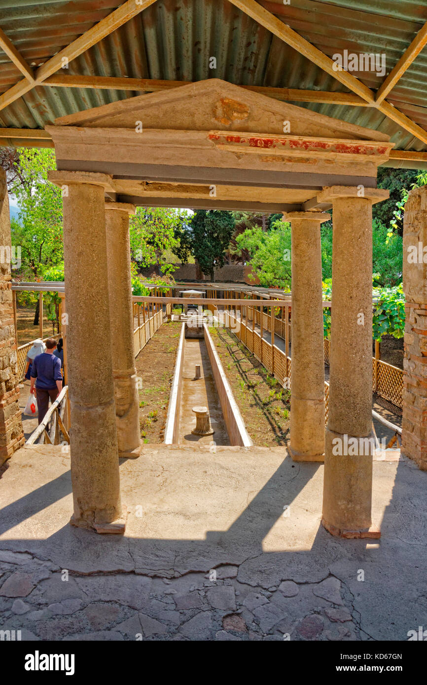 Garden and water course of the Octavius Quarto house at the ruined Roman city of Pompeii at Pompei Scavi, near Naples, - Stock Image