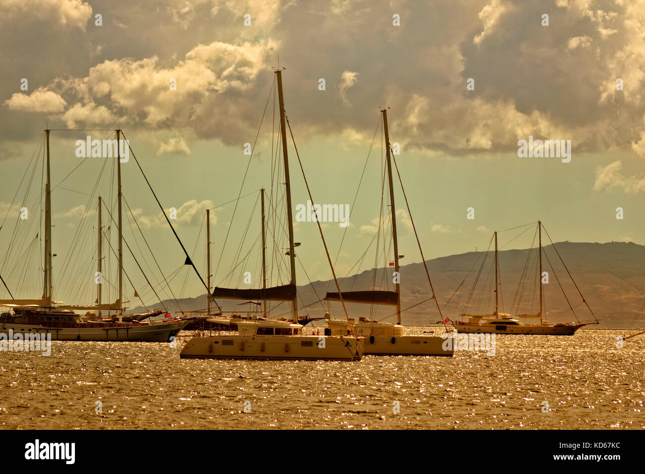 Yachts, catamarans at anchor at Bodrum, Mugla Province, Turkey. - Stock Image