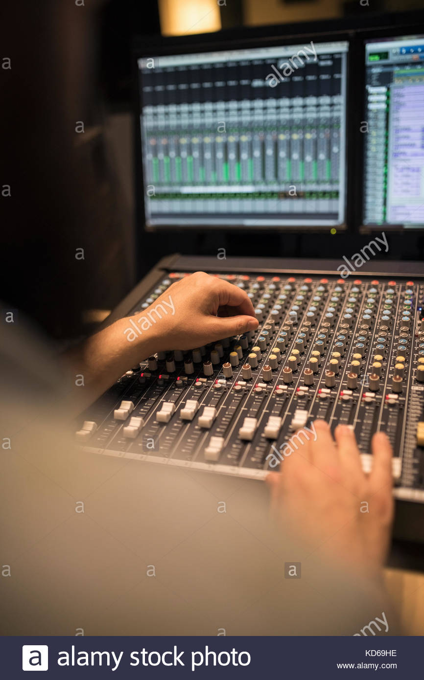 Male music producer working at sounder mixer in recording studio - Stock Image