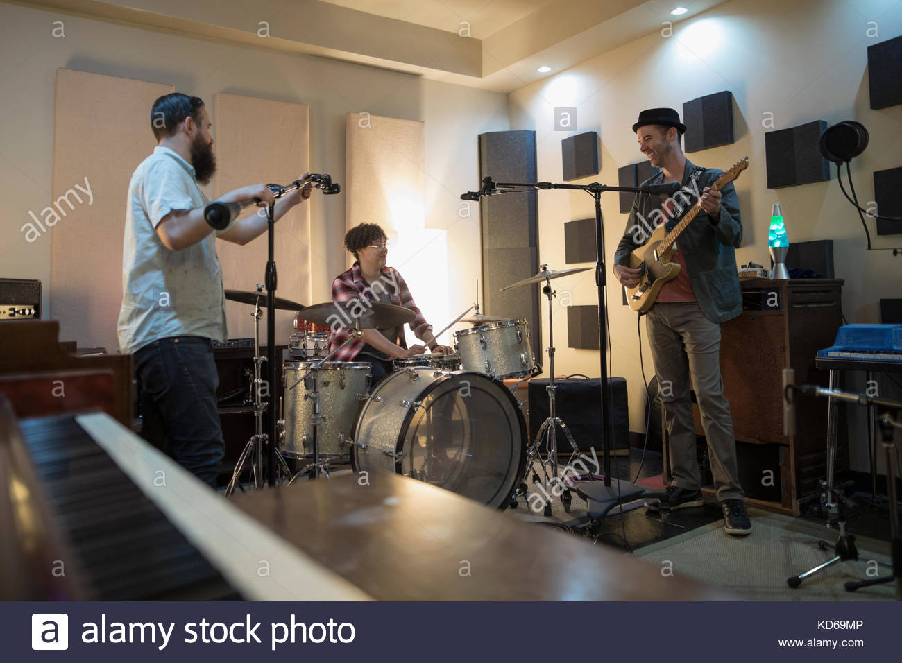 Musicians playing in recording studio - Stock Image