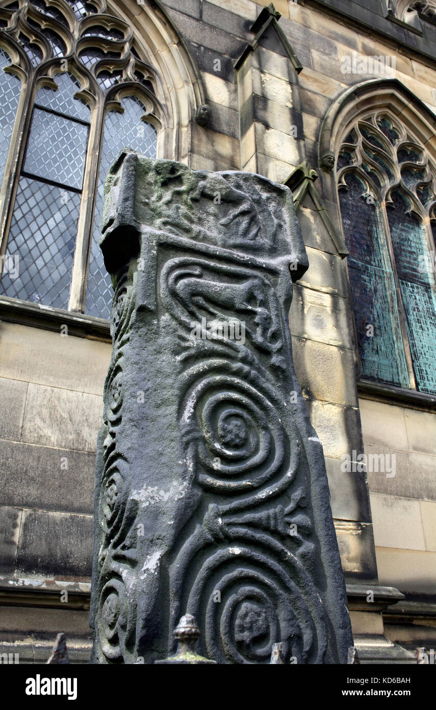Carved spiral scrollwork on an Anglo-Saxon cross (dating from 7th to 9th century), All Saints churchyard, Bakewell, - Stock Image