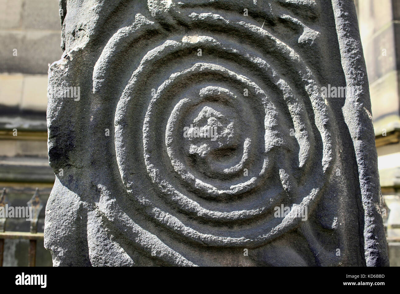 Close up of spiral scrollwork on a medieval cross, All Saints' churchyard, Bakewell, Derbyshire. - Stock Image