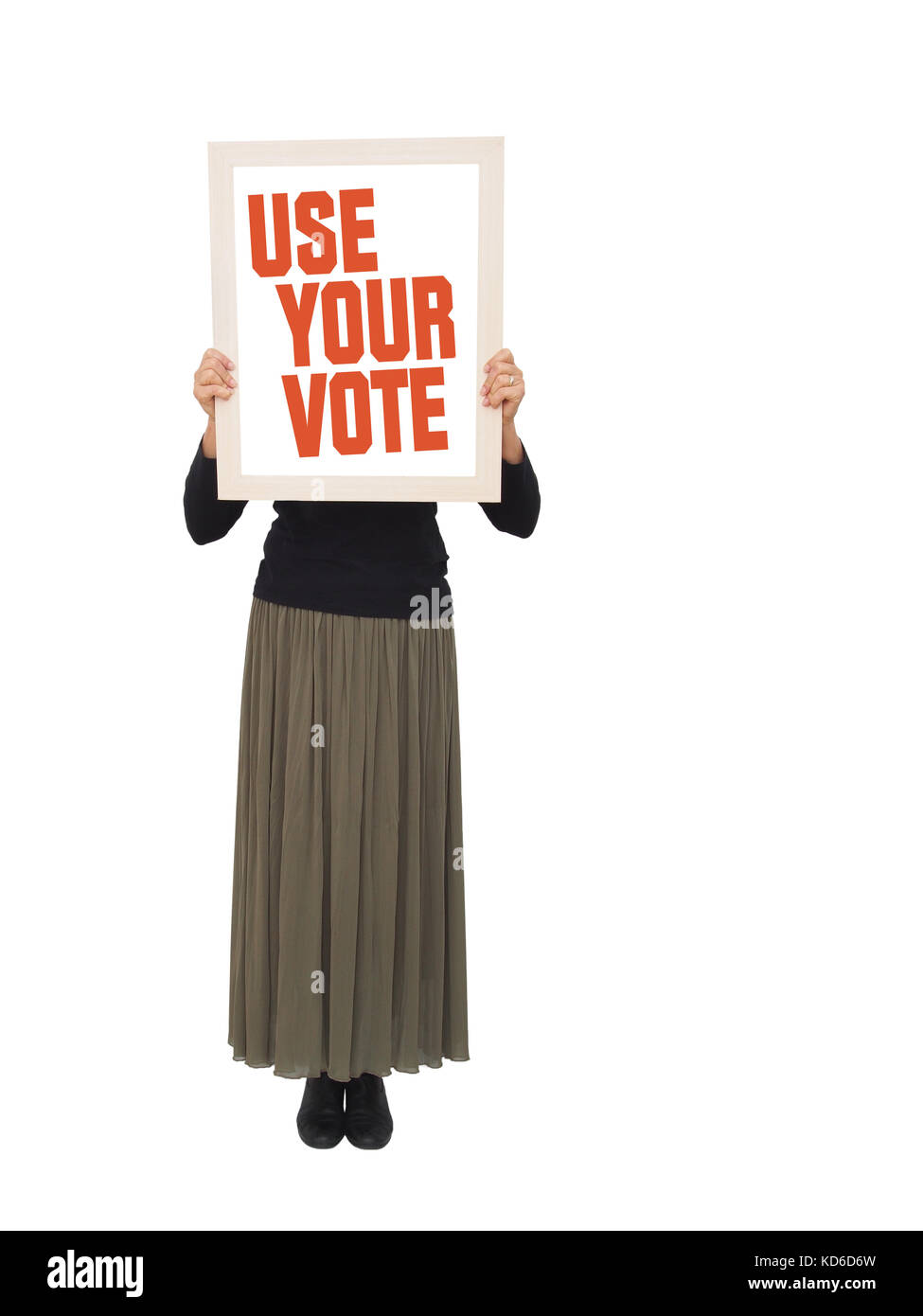 Woman with use your vote placard. - Stock Image