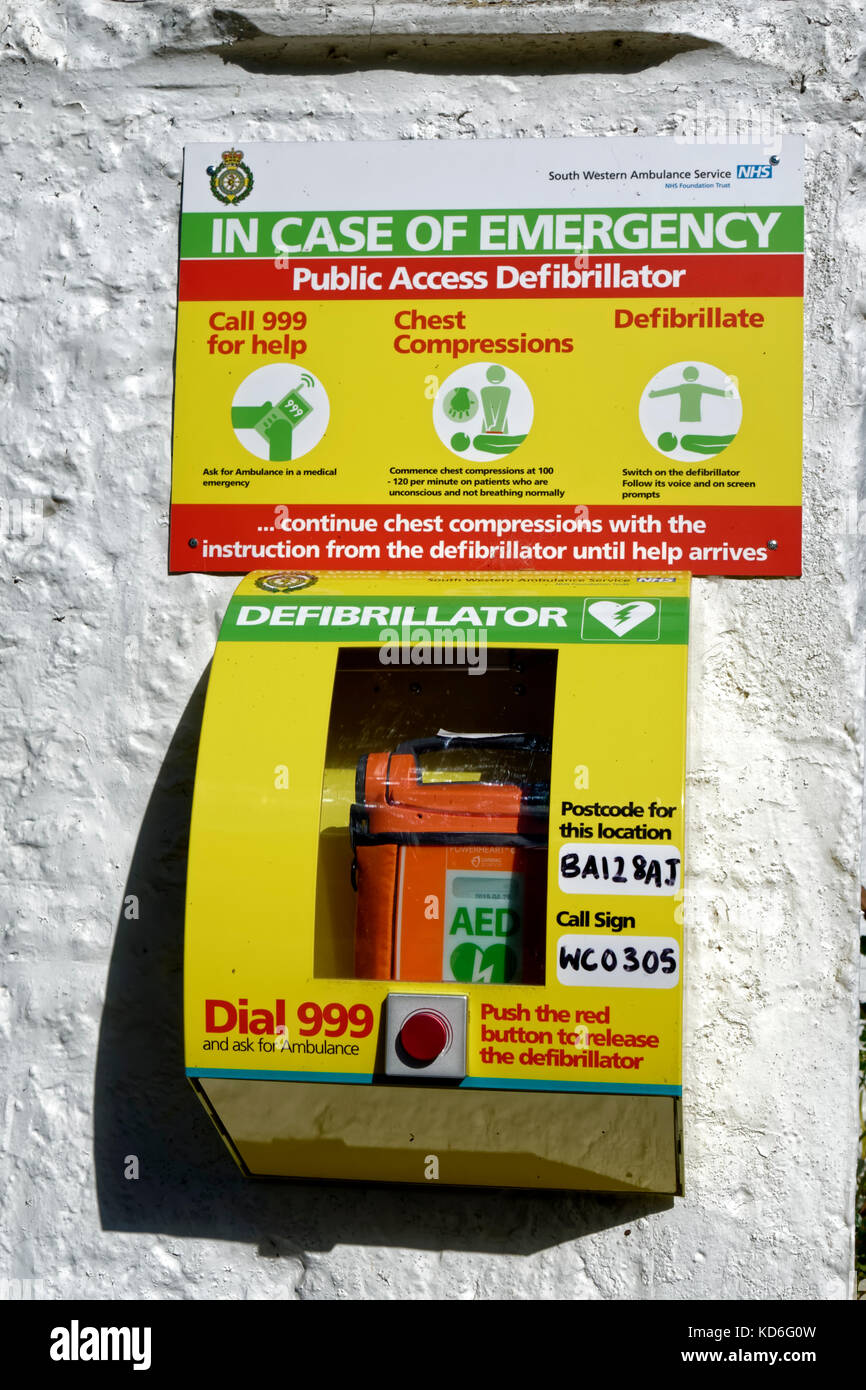 A Public Access Defibrillator attached to the outside wall of the Bath Arms Pub in Crockerton, Wiltshire, United - Stock Image