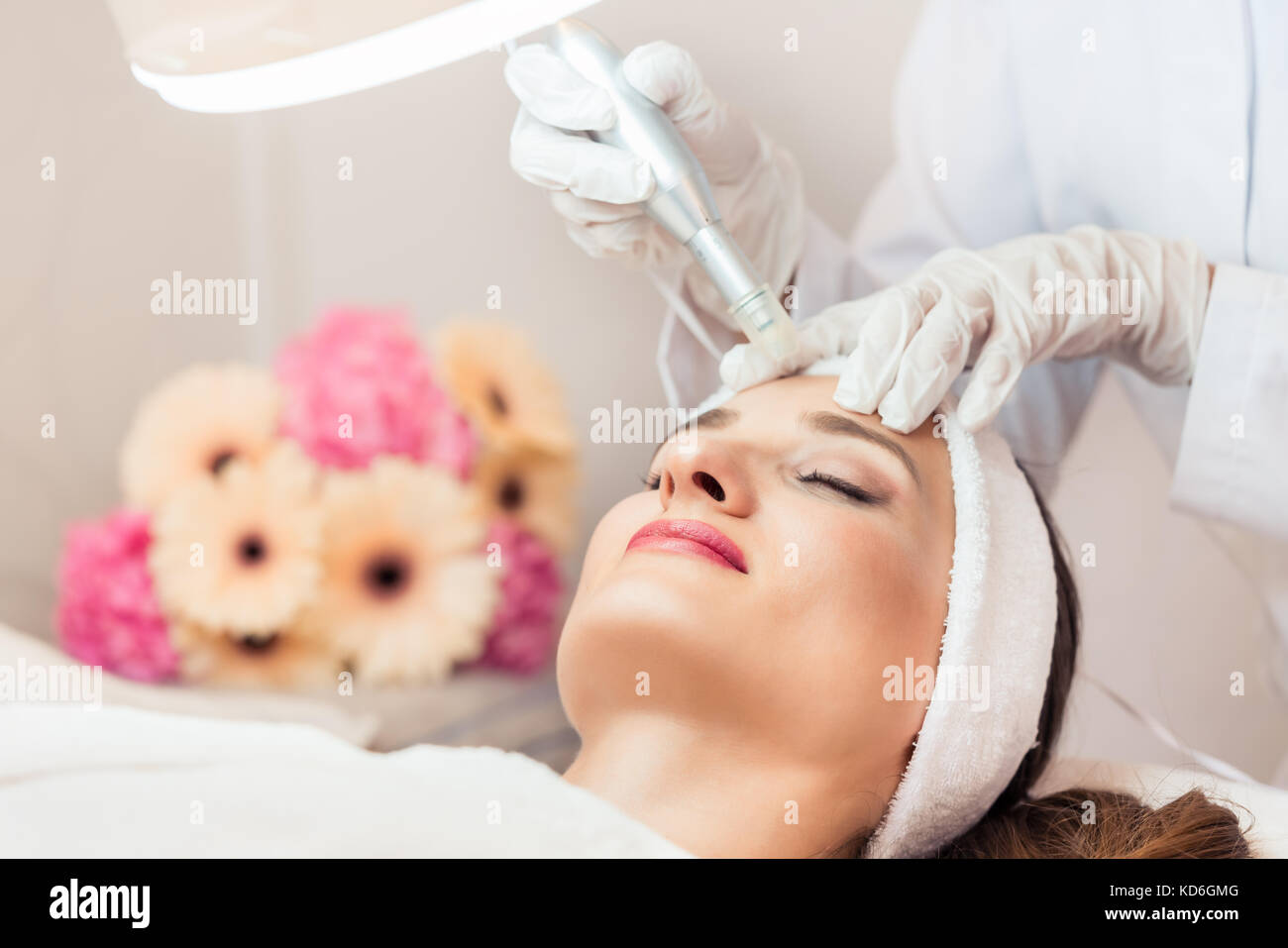 Close-up of the face of a woman relaxing during non-surgical fac Stock Photo