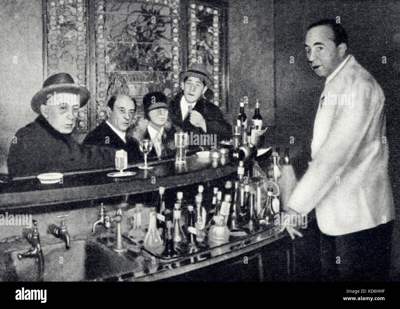 Arnold Schoenberg at bar with friends in Berlin. From left: Adolf Loos, Arnold Schoenberg, Gertrud Schoenberg, Oskar Kokoschka. Austrian composer, 1874-1951. Stock Photo