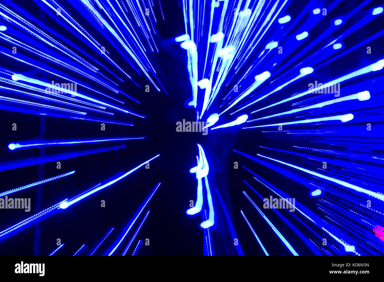 Speed of light - blue traces from points of light in space. - Stock Image