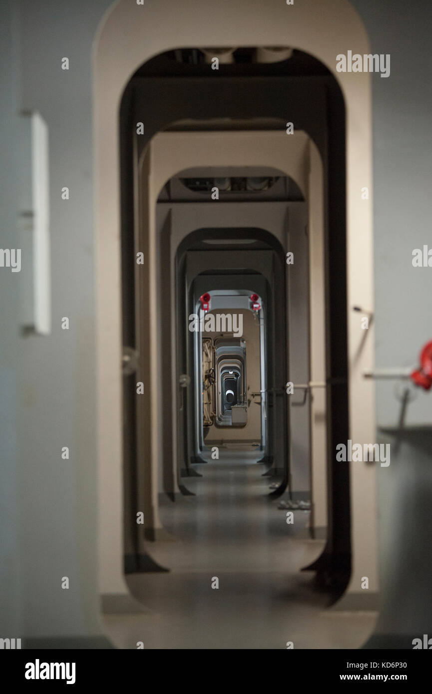 View through the bulkhead sections of a container ship, below decks - Stock Image