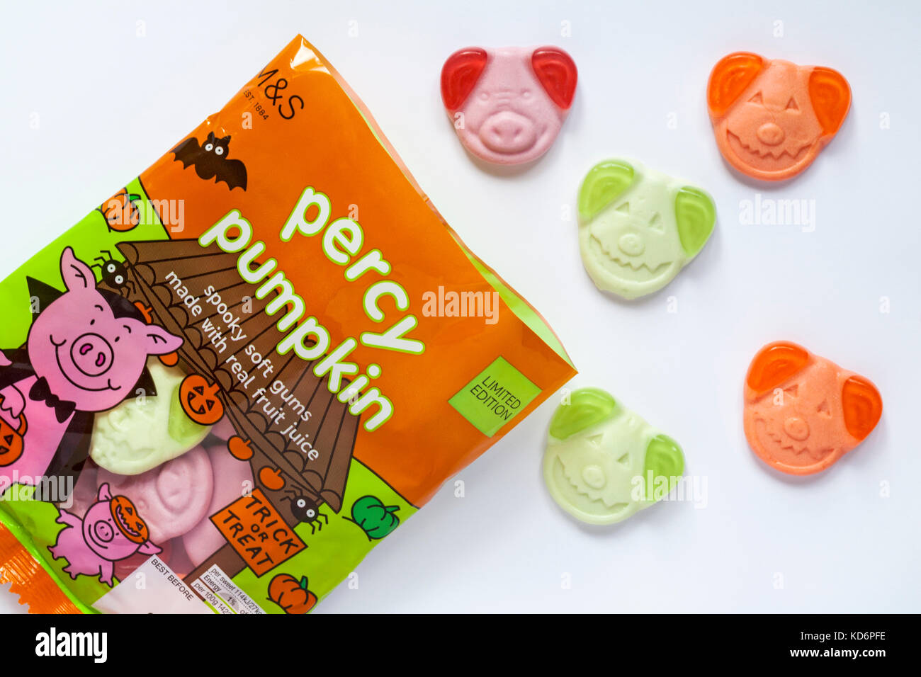 Open packet of M&S Percy pumpkin sweets spooky soft gums with real fruit juice ready for trick or treat Halloween - Stock Image