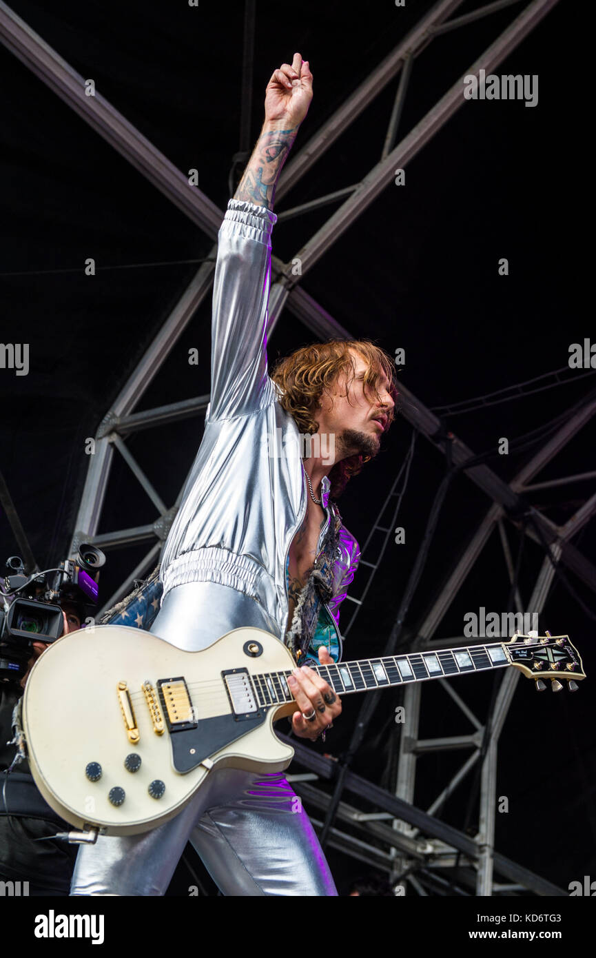 Justin Hawkins, lead singer and guitarist of The Darkness, performs live on stage at the Godiva Festival, Coventry, - Stock Image