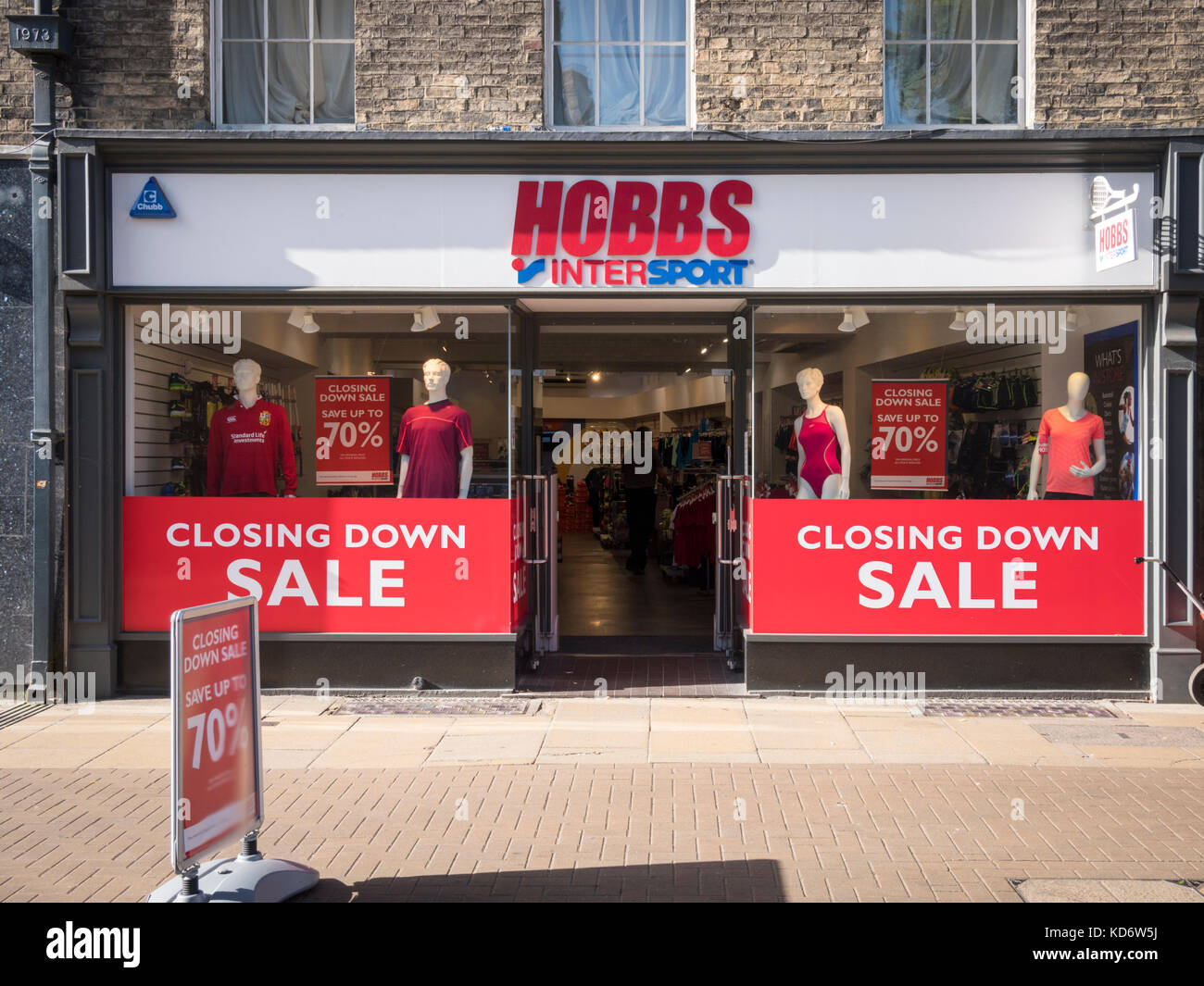 The Hobbs Sports Shop in Cambridge UK which is closing down.  The shop window has closing down sale signs in the - Stock Image